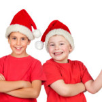 Two children with Christmas hats